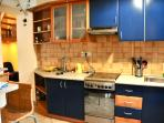 Kitchen with gas oven, micro, fridge, toaster and everything you need for cooking tasty foods. foo