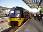 Ilkley Station (10 mins walk) has 4 trains every hour