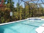 south west facing heated pool and spa with conservation views