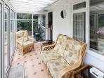 Relax in the light and airy conservatory whatever the weather.