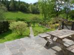 Relax in the sun and watchout for red squirrels, woodpeckers, deer and more. Garden to right of path