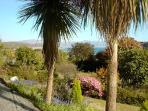 View across the front garden to sea.Wonderful to sit under verandah and see the sea.