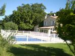 View of the house and secure pool
