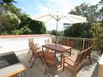 Outdoor dining: sundeck with patio furniture and BBQ