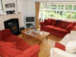 The lounge with log burner and lovely views over the garden and River Wye