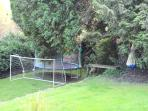 Goal, trampoline, zip wire at end of bottom garden