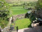View from master bedroom over patio, rear garden on to Rise Hill. Yorkshire dales National Park
