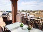 The terrace extends all around the apartment, facing the sea