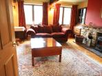 Living room with stove/fire & furnished to a exceptionally high standard throughout