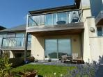 Pebbles is a beautiful apartment with patio and enclosed garden, sea views and parking