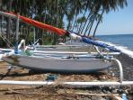 Local Jukung (fishing boats) on the beach in front of Pantai