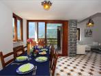 A mountain-view dining room and a separate fully-equipped kitchen