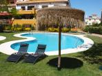 Pool area with loungers.Gated access for guests. Situated just below apartment.