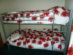 The second bedroom has bunk beds suitable for adults and children. All bed linen and towels are inc.