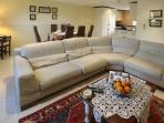 Comfy living area with Natuzzi leather sofas, open to dining area and kitchen