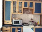 fully equipped kitchen with the complimentery mineral water