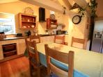 Large well equipped kitchen - the dining table extends