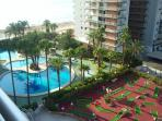 View from balcony of apartment of the pools, crazy golf and beach