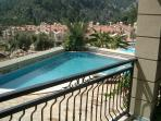 Large balcony overlooking Swimming pool and village and surrounding mountains