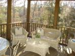 Screened porch overlooking stream in back