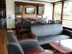 Front Area with TV and Sofa Set in Pournamis' 4 Bedroom Luxury Houseboat
