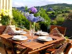 One of the stunning views from the terrace which includes table, chairs and a BBQ.