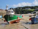 boats in St Ives harbour at low tide
