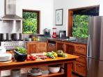 Cooking in the tropics has never been so cool as it is in this fabulous kitchen; views, social, yum!