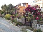 Villa Loumar, is on the corner of this flower lined street in Koca Calis village, opposite forrest.
