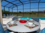 Al Fresco dining on the pool deck with views across the conservation area