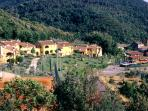 Panoramic view of our apartments, garden, parking and nearest old village of Iano