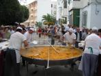 Enjoy a paella in a local fiesta