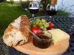 Enjoy the French way of life at Le Fournil, with wine, cheese and bread from our local market