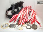 some sports medals in the vitrine