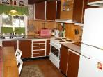 Kitchen containing Stove,Microwave,Fridge/Freezer and numerous kitchen appliences