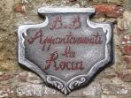 Coat of arms at the entrance of the 'Appartamenti La Rocca'