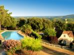 The swimming-pool and panoramic view at le Hameau du sentier des Sources