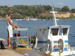 Cleaning/selling fish in Koroni
