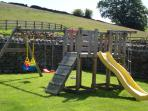 Our walled and gated garden with swing / slide combo just a couple of strides from Rossmoor Cottage
