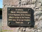 Plaque dedicated to Harold Schillingberg on the wall outside our cottage. Thank you.