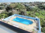 Fresh Water Swimming Pool with Spacious Sun Deck Area with Sun Loungers surrounding the Pool Area