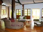 large open living area with doors to the veranda overlooking a large fish pond