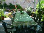 Il giardino per le cene estive all'aperto