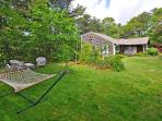 Lush yard with lounging hammock, The Cherry Suite, Cottage Guest, Eastham, MA, Cape Cod
