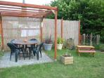 Secluded guest garden with BBQ,childs bench and additional deck chairs for lounging!