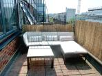 Sunny private terrace with comfortable seating