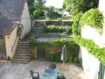 Steps leading from the side of the gite to the garden and swimming pool