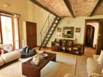 Upper floor bedroom with sitting room and bathroom below and bed on mezzanine