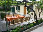 The peaceful garden seating area is a favorite feature of the house