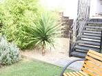steps from kitchen to private garden